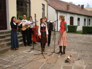 with Danica and her orchestra, outside the church (Ajde Kato)